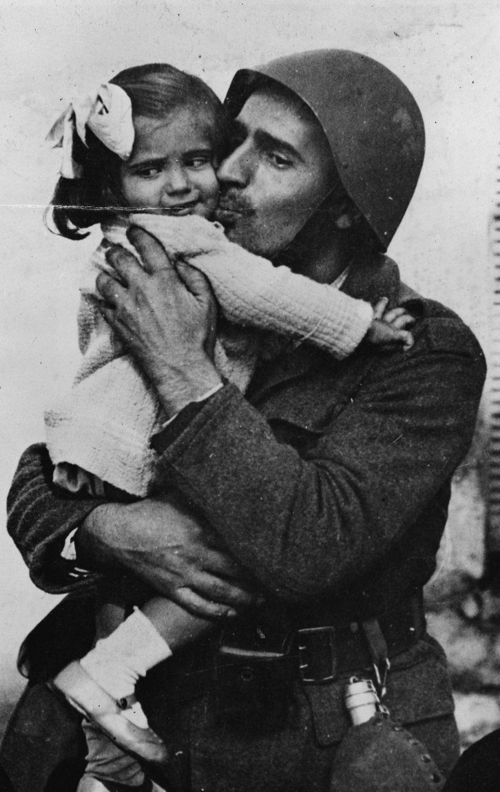 A-Greek-soldier-holding-his-little-daughter-in-his-arms