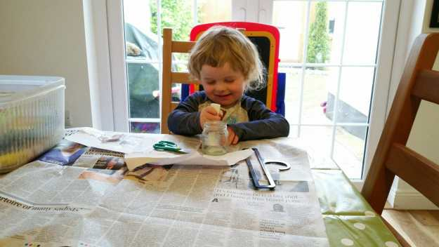 Small boy busy doing his own made-up art - and there's my new table cloth