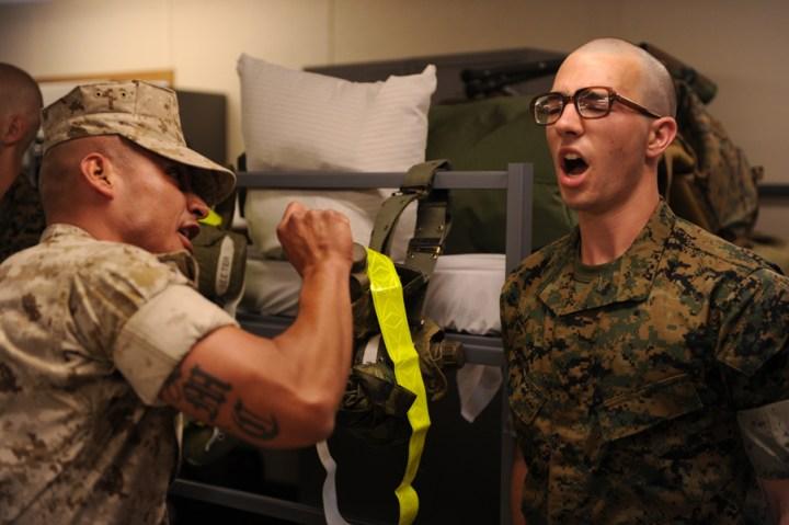 OCS Sergeant Instructor holding glow belt intimidates candidate