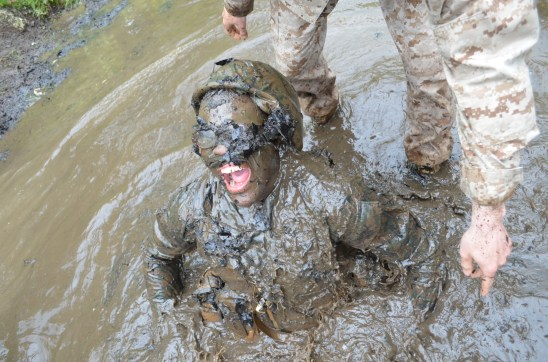 A muddy candidate gasps for air after getting stuck in the underwater portion of the Quigley