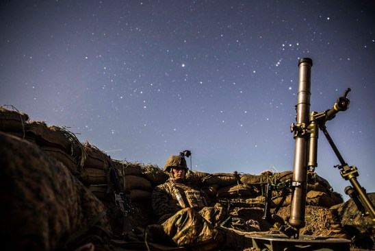 Lance Cpl. Griffin Forrester stands his post in his fighting hole during a beach raid aboard Camp Pendleton, California, March 6, 2015. After securing the beach, Marines tactically moved to Camp Horno, where the Marines dug fighting holes and trained in defensive tactics during Amphibious Squadron/Marine Expeditionary Unit Integration Training.