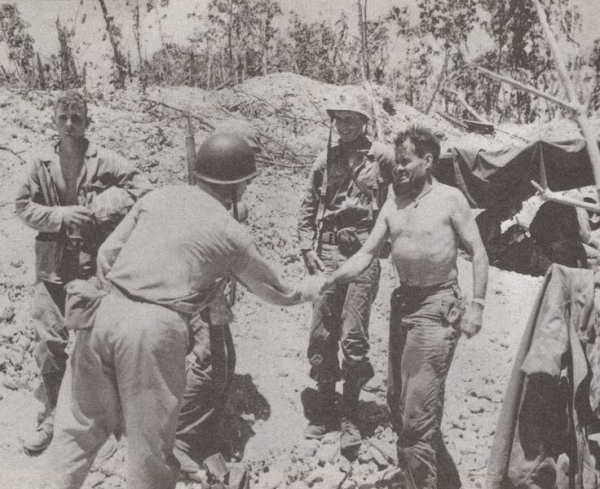 Shirtless in the mud. Marine Col Chesty Puller greets a Navy Admiral at the 1st Marines command post on Peleliu, Sep 18 1944.
