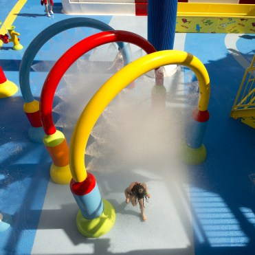 A youngsters runs through spray rings aboard the Carnival Horizon's Dr. Seuss WaterWorks Park. Photo by Andy Newman/Carnival Cruise Line