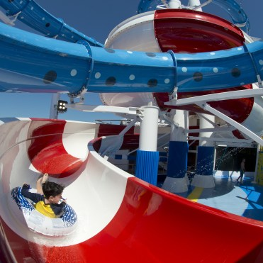 A youngster slides down the Cat in the Hat water slide, that is a facet of the Dr. Seuss WaterWorks Park onboard the Carnival Horizon. Photo by Andy Newman/Carnival Cruise Line