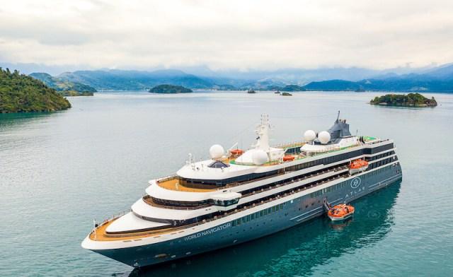 Atlas Ocean Voyages World Navigator and tug
