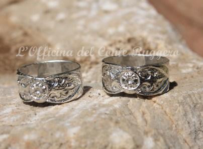 Due #anelli in argento per due #fidanzati : palmette normanne e foglie stilizzate a sbalzo e cesello.