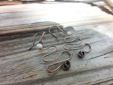 Copper wire with a white stone top