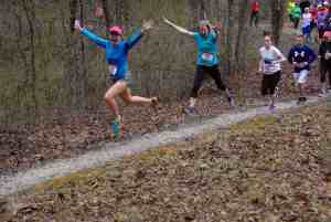 Jami Dix and Susan Giles jump for joy in the opening mile of the Alpine Shop Shaw Bloom 10K/20K Trail Run presented by The North Face.