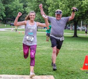 Alyssa and Ray Hummel Jr cross the finish line together during the May 26 Marmot Trail Run Series