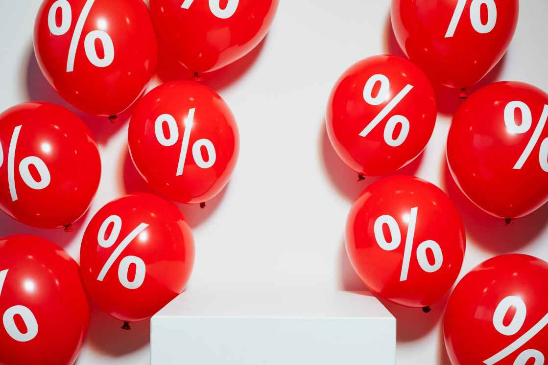 red balloons with percent sign