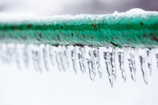 Frozen icy down pipe