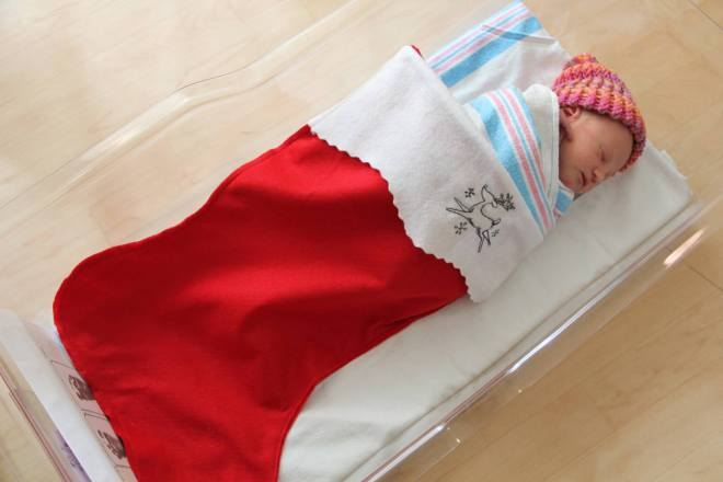 A baby in a stocking.