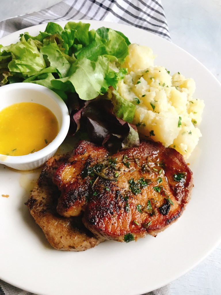 pork chops with potatoes and salad