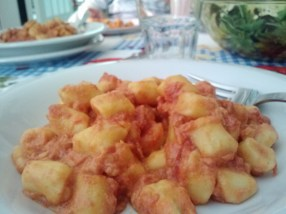 Gnocchi al salmone. Homemade potato pasta with salmon.