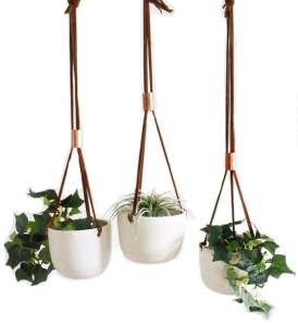 Love the look of bohemian bedroom decor, but need a little guidance pulling it all together? Check out this boho bedroom shopping guide - featuring eco-conscious items like these handmade porcelain hanging planters from ethical marketplace Made Trade.