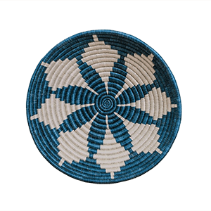 Whether your decor style is Boho, Coastal - even Minimalist - there's a set of woven basket wall decor out there with your name on it! And you can start with the Blue Night Hope Wall Basket from ethical brand KAZI.