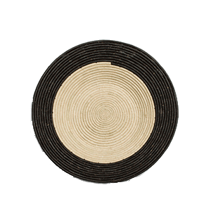 Whether your decor style is Boho, Coastal - even Minimalist - there's a set of woven basket wall decor out there with your name on it! And you can start with the Dipped Black + Natural Raffia Basket from ethical brand KAZI.