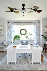 Try sticking to a color scheme for your home office. Isn't this blue absolutely lovely?