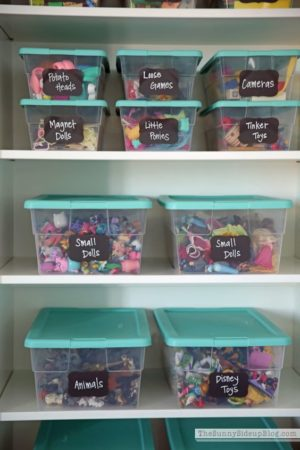 Organize your kid's toys by using plastic bins and chalkboard labels.