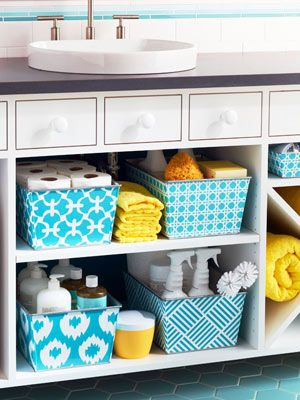 Mix and match colorful baskets under your bathroom sink for storage.
