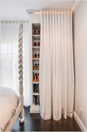 Using a simple bookcase, hang a curtain in front of it for discreet shoe storage.