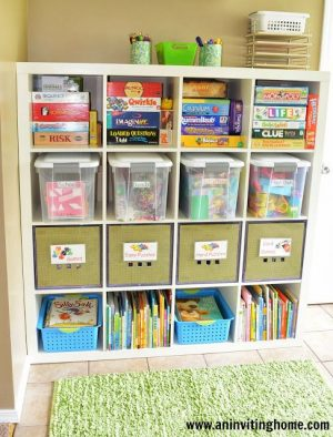 Turn a bookshelf into a toy and book storage unit. I love the green bins!