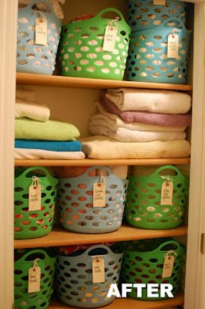 Use cheap dollar store bins to organize your linen closet. I love this idea!