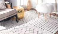 """How lovely is this distressed patterned area rug? This would pair great in a home office or """"girl cave""""."""
