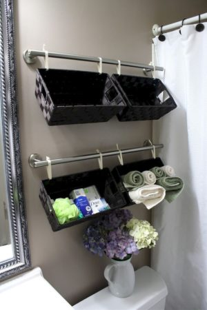 Install a set of towel bars on the wall behind your toilet and hang baskets from them for additional storage.