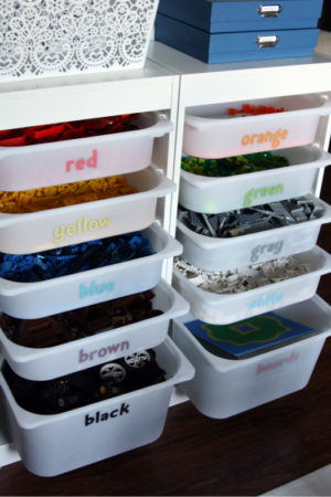 Organize legos by placing them in plastic bins labeled by color.