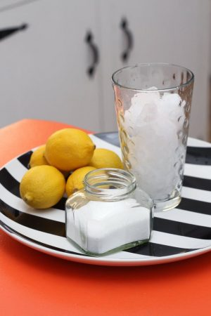 Rock salt, lemon and vinegar is an excellent all natural cleaner for your garbage disposal.