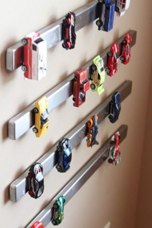 Attach a magnetic steel strip in the playroom for toy car storage.