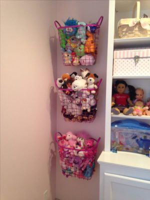 Organize stuffed toys and animals using wire baskets attached to the wall with command hooks.