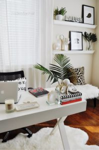 Add an animal print pillow to your home office to spice things up! This home office is so glam!