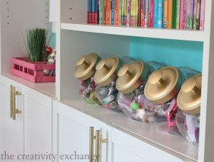 Use candy jars to organize your daughter's accessories. Repin if you think this is brilliant!