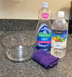 2 tablespoons white vinegar and a few squirts of dish detergent to clean your kitchen cabinets and countertops.
