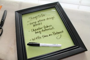 Add fabric to the inside of a dollar store picture frame and use it as a dry erase board! Repin for later!
