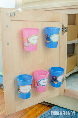 Use dollar store cups to store and organize your kid's toothbushes underneath the bathroom sink. I must repin this to remember later!