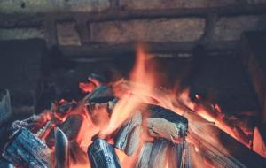 Sprinkle wet coffee grounds in your fireplace before cleaning. This will help prevent dust getting into the air as well as make it easier to clean.