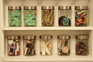 glass canister makeup organization - 15 Cheap and Easy Ways to Organize Your Makeup in a Small Bathroom