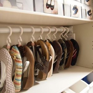Japanese shoe organization hack. Install tension rod in closet and hang shoes. This will save a ton of space.