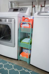 Use a laundry cart to store cleaning supplies between your washer and dryer. Repin if you think this is brilliant!