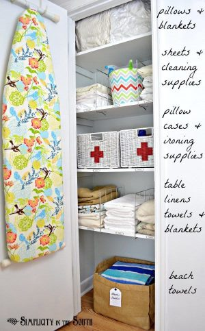 I like the first aid baskets in this linen closet. Repin!