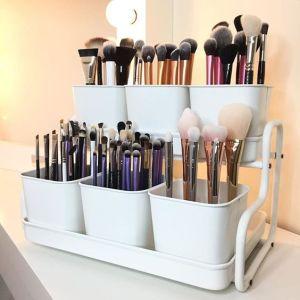 Turn a plant pot holder into a makeup organizer.