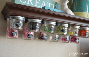 Make your own mason jar storage shelf for your craft room.