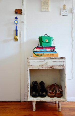 Repurpose flea market finds to add storage space to a tiny apartment or room.