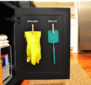 Use clothes pins to hang your rubber gloves and fly swatter underneath your kitchen sink.