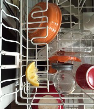 Make your dishes sparkle and smell heavenly! IF a recipe calls for a lemon, throw the leftover rind in the dishwasher. I love this hack to keep my dishes clean! Repin for later!
