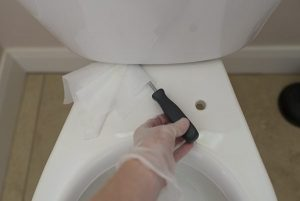 Clean underneath your toilet tank to get those hidden germ spots.