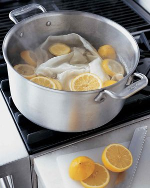 Soak white lemons in a pot of hot water and lemon to naturally bleach stains out of them.